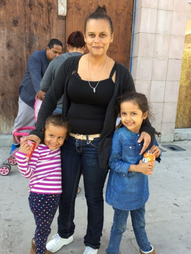 A woman and two children pose for a photo near the US-Mexico border, 29 April 2018