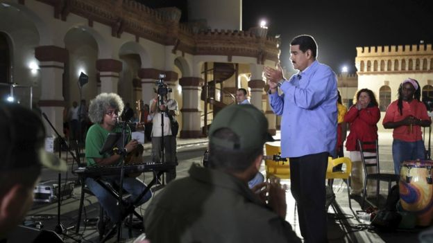 President Nicolas Maduro applauds during his weekly broadcast