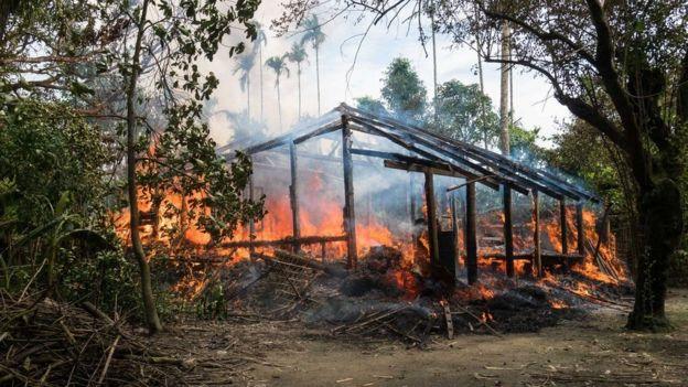 Sebuah desa Rohingya yang terbakar pada 7 September - Suu Kyi mengatakan kekerasan sudah berhenti sebelum tanggal itu.