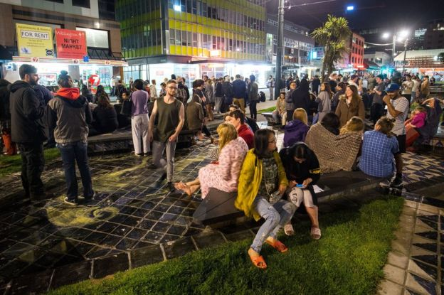 People wait in Te Aro Park after being evacuated from nearby buildings following an earthquake on 14 November 2016 in Wellington, New Zealand