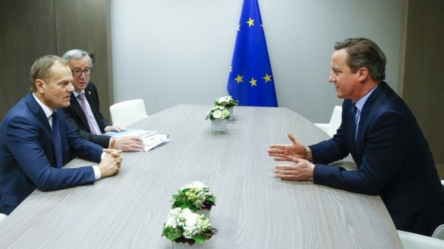 European Council President Donald Tusk, left, and European Commission President Jean-Claude Juncker, with UK Prime Minister David Cameron