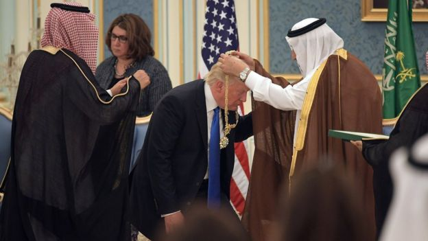 US President Donald Trump receives the Order of Abdulaziz al Saud medal from Saudi Arabia's King Salman bin Abdulaziz Al Saud