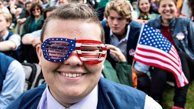 A man in American flag glasses attends an Independence Day celebration in Rebild National Park in Rebild, Denmark July 4, 2017