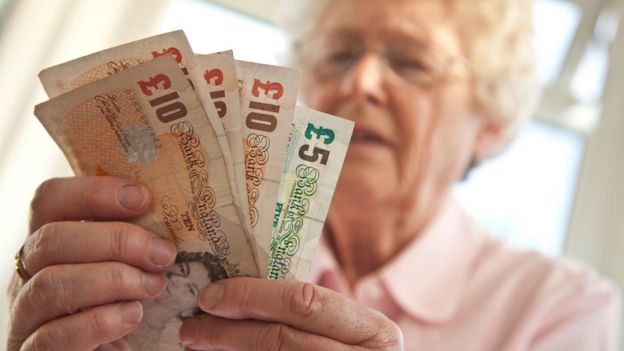 Pensioner holding money