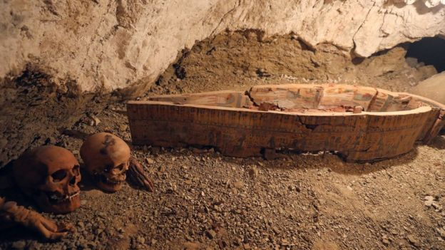 Skulls and hands are seen next to coffin in the recently discovered tomb of Amenemhat, a goldsmith from the New Kingdom, at the Draa Abu-el Naga necropolis