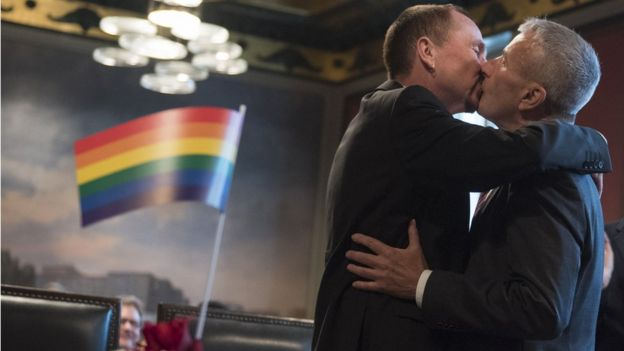 Karl Kreile and Bodo Mende kiss each other during their wedding in Berlin on 1 October 2017