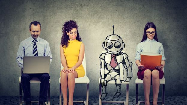 A robot between three people
