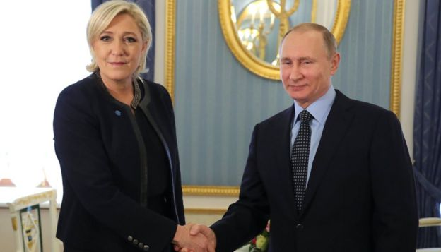 Russian President Vladimir Putin shakes hands with Marine Le Pen, French National Front (FN) on 24 March 2017