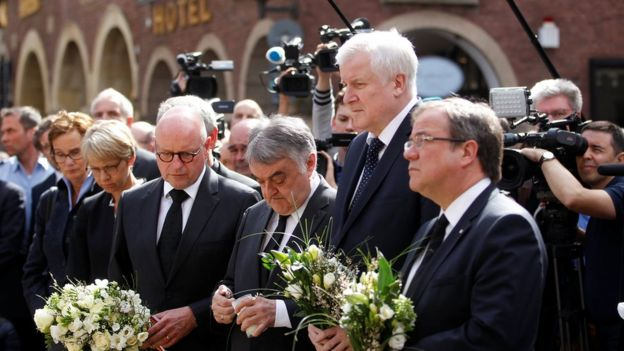 Muenster Mayor Markus Lewe, North Rhine Westphalia (NRW) Internal Affairs Minister Herbert Reul, German Interior Minister Horst Seehofer and NRW Minister-President Armin Laschet mourn at the site where, on April 7, a man drove a van into a group of people sitting outside a popular restaurant in the old city centre of Muenster.
