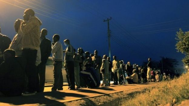 Kenyans wait to cast their vote at a polling station in Kibera in the capital Nairobi 4 March 2013