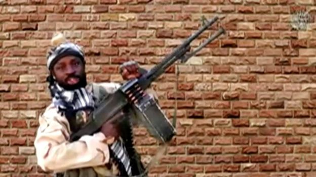 Leader of one of the Boko Haram group's factions, Abubakar Shekau holds a weapon in an unknown location in Nigeria in this still image taken from an undated video obtained on January 15, 2018.