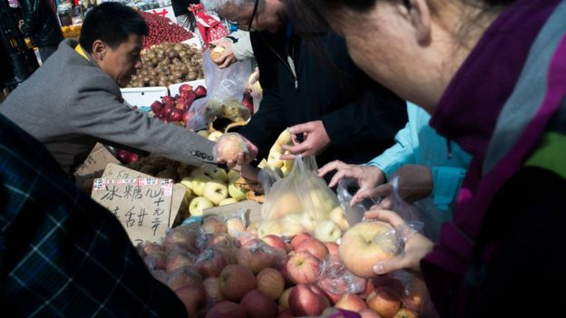 Chinese shoppers and market traders