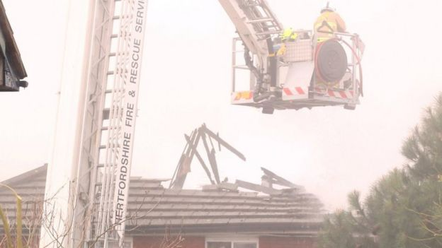 Badly fire-damaged roof at care home.