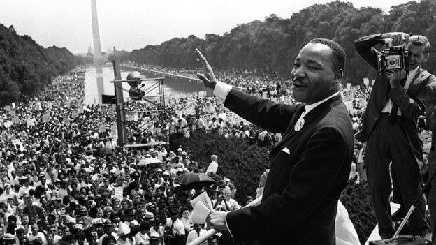 Civil rights leader Martin Luther King (C) waves to supporters 28 August 1963 on the Mall in Washington, DC,