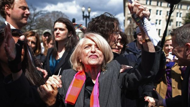 Edith Windsor is mobbed by journalists and supporters as she leaves the Supreme Court in Washington DC 27 March 2013