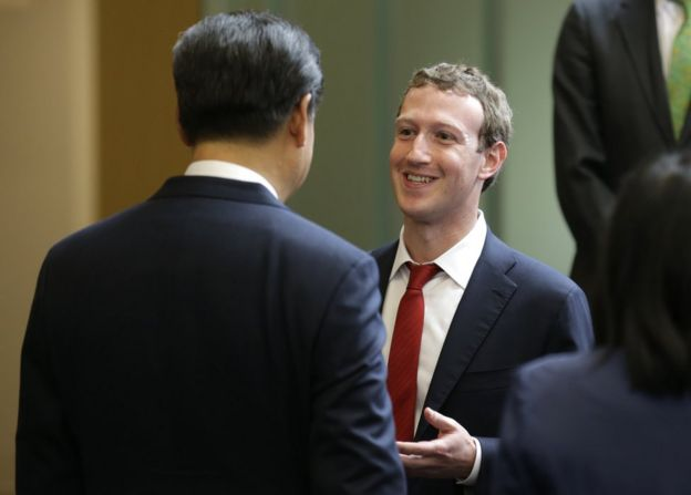 Chinese President Xi Jinping, left, talks with Facebook Chief Executive Mark Zuckerberg, right, during a gathering of CEOs and other executives at Microsoft