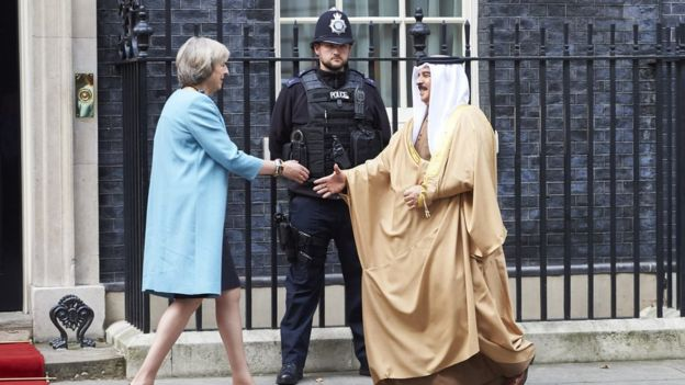 British Prime Minister Theresa May greets King Hamad of Bahrain outside 10 Downing Street in London on 26 October 2016