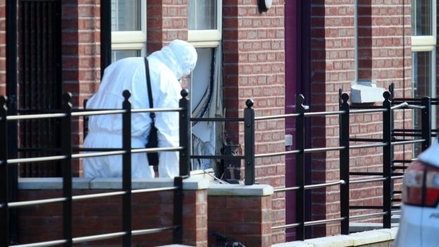 A forensic officer at the scene of the Lisburn attack