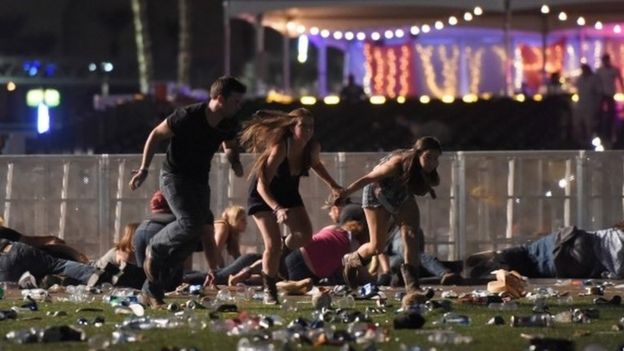 People run from the Route 91 Harvest country music festival after apparent gun fire was heard on October 1, 2017 in Las Vegas