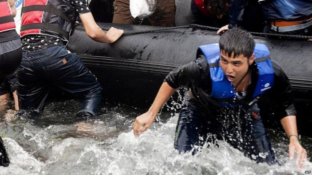 A migrant lands on the Greek island of Lesbos