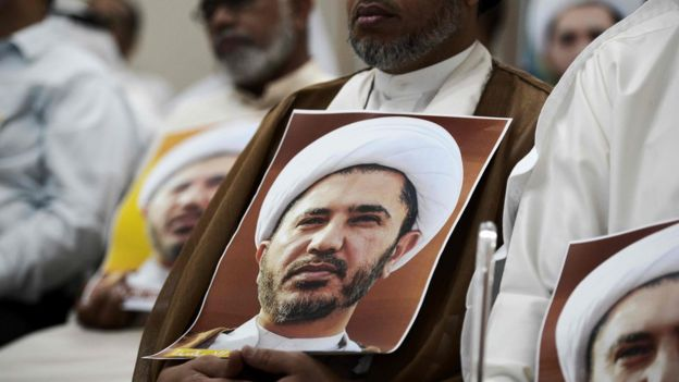 Bahraini man holding a placard bearing the portrait of Sheikh Ali Salman (29 May 2016)