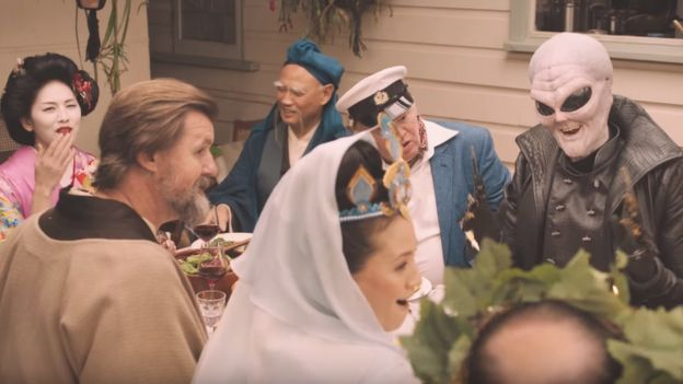A still from a lamb advert depicting various religious figures sharing a meal
