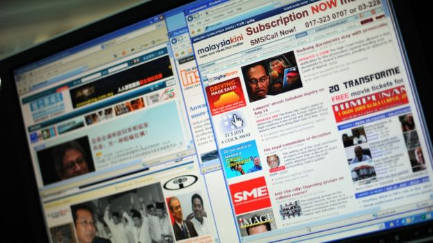 Malaysian news portals on a computer screen.