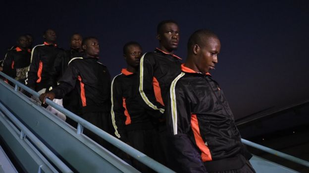 Returnees alight from a chartered aircraft that brought home 150 migrants from Libya at the Murtala Mohammed International Airport in Lagos, on December 5, 2017.