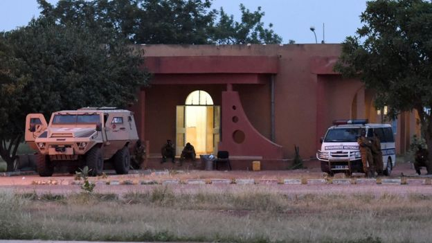 Soldiers stand guard by Naba Koom II barracks, base of Presidential Security Regiment (RSP) in Ouagadougou on September 30, 2015