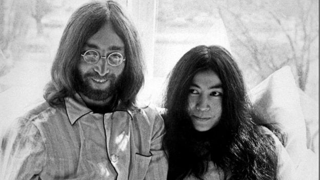 File image taken 25 March 1969 shows late Beatles singer John Lennon and his wife, Yoko Ono, at the Hilton Hotel in Amsterdam