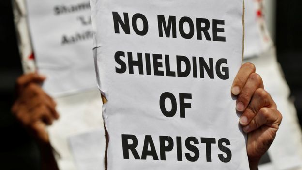 "Indian activists hold placards that read in Hindi ""Indian Government take stern action against the rapists"" as they protest against the alleged rapes Uttar Pradesh and Jammu and Kashmir, in New Delhi, India, 12 April 2018."