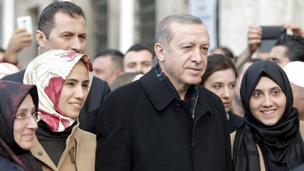 Turkish President Tayyip Erdogan, accompanied by his daughter Sumeyye Erdogan (second left), poses with his supporters as he leaves the Eyup Sultan mosque in Istanbul, Turkey, 2 November 2015