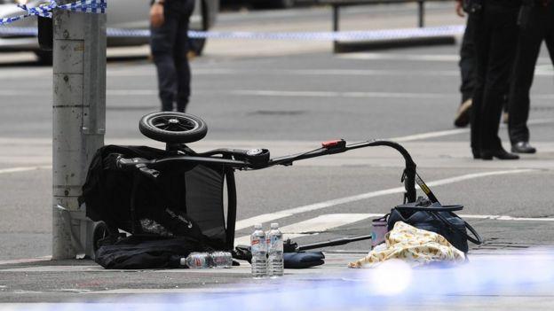 Overturned pram at scene where car struck pedestrians in Melbourne