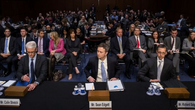 Social media representatives at a congressional hearing