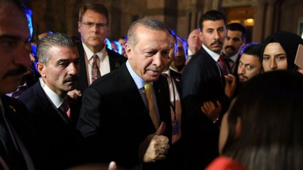 Turkish President Tayyip Erdogan gives a thumbs up to supporters outside of The Peninsula hotel on the sidelines of the United Nations General Assembly in Manhattan, New York, U.S. September 20, 2017.