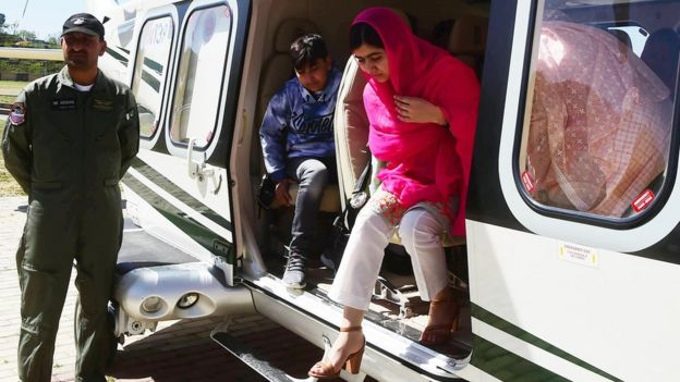 Malala Yousafzai comes out from an helicopter upon her arrival