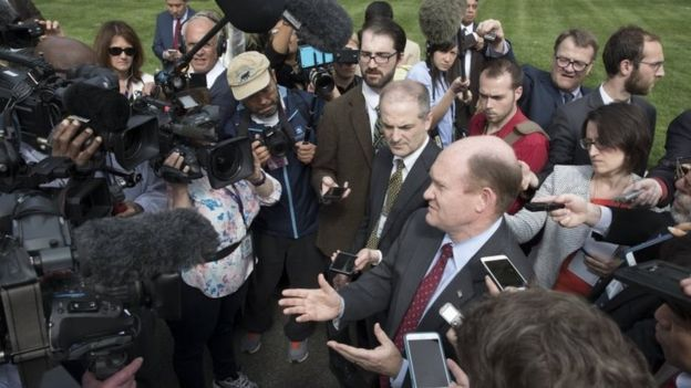 Democratic Senator from Delaware Chris Coons (centre) speaks to journalists following a briefing on North Korea attended by US Senators and Trump administration officials at the Eisenhower Executive Office (26 April 2017)