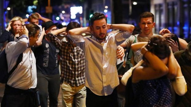 People leave attack area with hands up