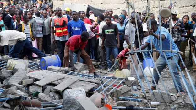 Emergency personnel at the scene of a collapsed building in a residential area of Nairobi, 13 June 2017