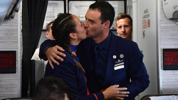 Airline staff Paula Podest and Carlos Ciufffardi kiss after being married by Pope Francis during the flight between Santiago and the northern city of Iquique, Chile, 18 January 2018