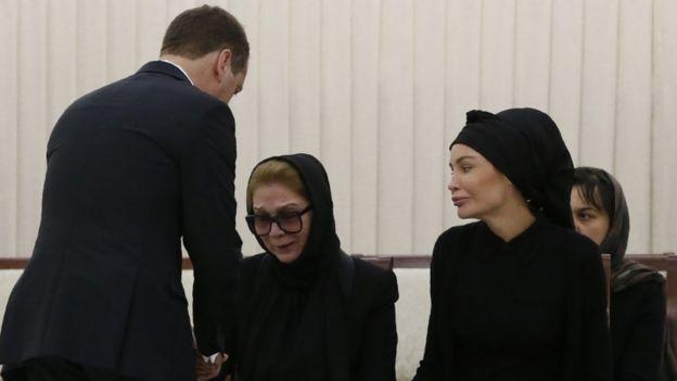 Russian PM Dmitry Medvedev consoles Tatyana Karimova and Lola Karimova-Tillyaeva