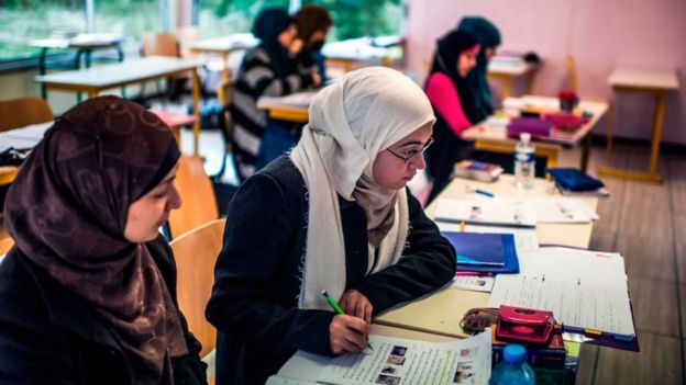 While the hijab is banned in some public buildings in France, students can wear them at universities