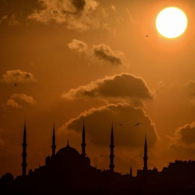 The sun sets over Sultanahmet mosque (also known as the Blue mosque) in Istanbul, Turkey