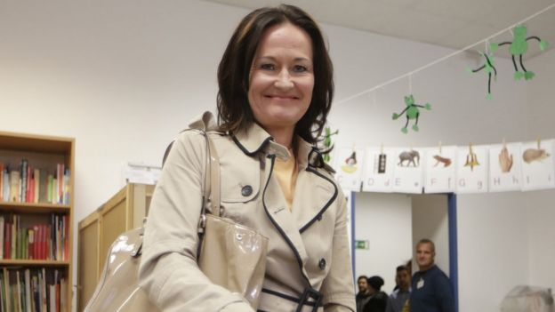 The head of the Austrian Green party, Eva Glawischnig, casts her ballot at a polling station in Vienna, Austria on 29 September, 2013.