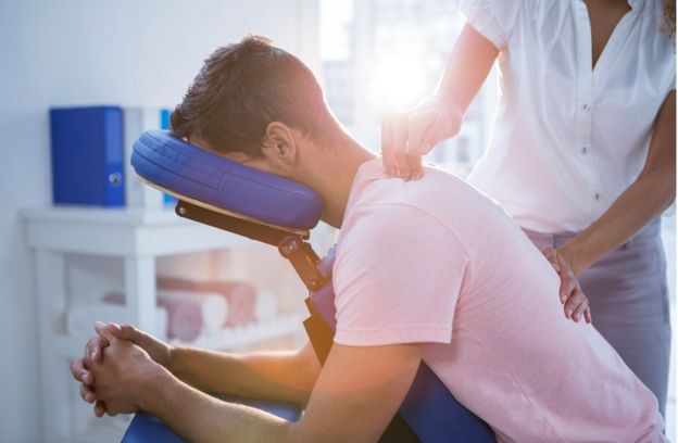 Man receiving physiotherapy.