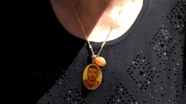 A mother in Homs with a locket of her lost son