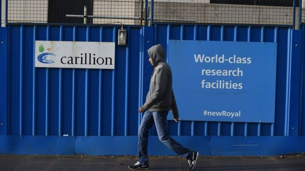 Man walks past Carillion building site