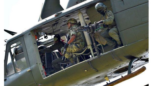 A military helicopter flies over Michoacan State