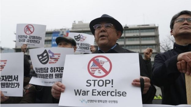"South Korean protesters hold banners reading ""Stop War Exercises"" during a rally against South Korea and US military forces joint ""Key-Resolve / Foal Eagle"" military exercises near the US embassy in Seoul, South Korea, 21 March 2018"