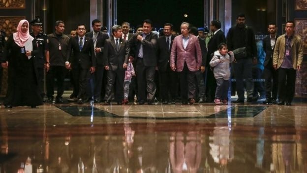 Malaysia's Foreign Minister Anifah Aman (6-R) walks with the nine Malaysian citizens after they arriving at the Bunga Raya complex, Kuala Lumpur International airport in Sepang, Malaysia, 31 March 2017.
